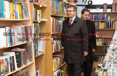 Piotr Wilczek, Poland's ambassador to the United States, takes a look at the Polish language books on the shelves at Quo Vadis, a Polish bookstore and gift shop, on Broad Street in New Britain, April 1, 2017. (Photo by Christopher Zajac)