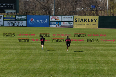 041117  Wesley Bunnell   Staff  The New Britain Bees held their media day on Tuesday afternoon before holding open tryouts later in the evening. Kevin Putkonen ,left, and Michael Baca run in the outfield grass as the conclusion of pactice.