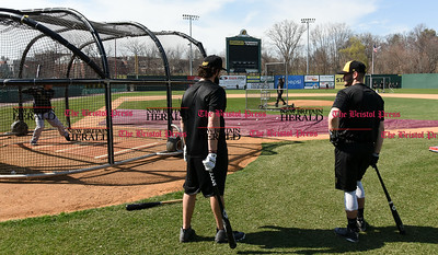 041117  Wesley Bunnell   Staff  The New Britain Bees held their media day on Tuesday afternoon before holding open tryouts later in the evening. Coach Daisuke Yoshida throws batting practice to catcher Ivan Villaescusa as Kevin Putkonen and Cody Charnesky stand outside of the cage.