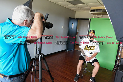 041117  Wesley Bunnell   Staff  The New Britain Bees held their media day on Tuesday afternoon before holding open tryouts later in the evening. Jeff DiCosimo of Premier Portraits Studio photographs Bees player Joe Beimel (45) for his official team photo.