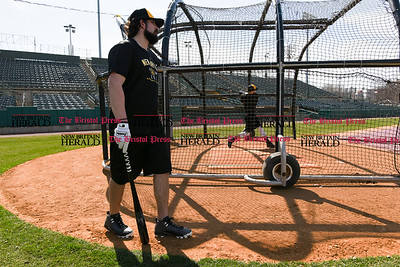 041117  Wesley Bunnell   Staff  The New Britain Bees held their media day on Tuesday afternoon before holding open tryouts later in the evening. Kevin Putkonen stands by the batting cage as bullpen catcher Cody Charneski takes his swings.