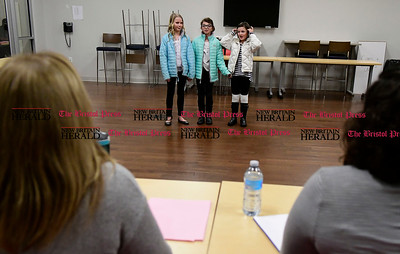 """1/19/2017 Mike Orazzi   Staff Elena Thomasson, Julia Riedel and Elle Thomasson sing while auditioning for the 76th annual Older Members (OM) Show, """"There's No Place Like Home."""" held at the Bristol Boys & Girls Club Thursday evening. Show dates this year are April 21 and 22."""