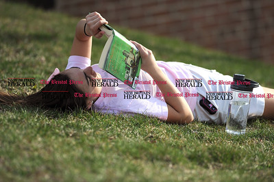 4/11/2017 Mike Orazzi   Staff Bristol Eastern student Anna Santacroce reads a book in the sun Tuesday afternoon school.