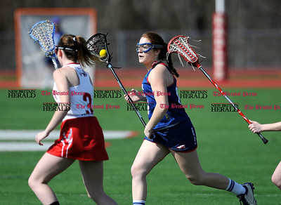 4/12/2017 Mike Orazzi | Staff St. Paul's Anne Sullivan (11) during Wednesday's lacrosse at Wolcott High School.