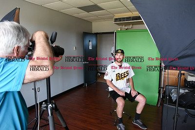 041117  Wesley Bunnell | Staff  The New Britain Bees held their media day on Tuesday afternoon before holding open tryouts later in the evening. Jeff DiCosimo of Premier Portraits Studio photographs Bees player Kyle Simon (18) for his official team photo.