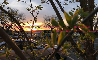 4/11/2017 Mike Orazzi   Staff Sunset on Main Street in Bristol as new buds form leaves after a couple of warm days and some sunshine.