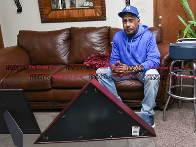 041317  Wesley Bunnell | Staff  Selwyn Cartie Sr. discusses the details of the Feb 22. 2009 shooting death of his son Julian Cartie while sitting in front of a folded American Flag from his funeral. Julian's killer Michael Rodriguez was recently convicted and is set to be sentenced on April 19 in Springfield Mass. where the shooting occurred.