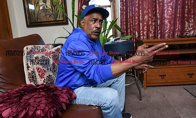 041317  Wesley Bunnell | Staff  Selwyn Cartie Sr. makes a shooting motion as he discusses the details of the Feb 22. 2009 shooting death of his son Julian Cartie. Julian's killer Michael Rodriguez was recently convicted and is set to be sentenced on April 19 in Springfield Mass. where the shooting occurred.