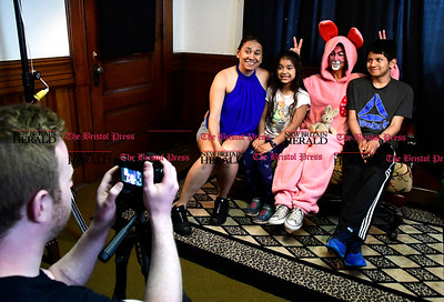 4/15/2017 Mike Orazzi | Staff Members of the Suarez family, l to r: Christina, Araceli and Vicente, pose with the Easter bunny, Annie Salgado during the Annual Easter Egg Hunt at Trinity-on Main Saturday in New Britain.