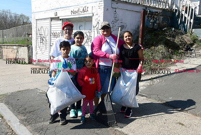 4/15/2017 Mike Orazzi | Staff Volunteers while cleaning up on Oak Street during the The North Oak-Neighborhood Revitalization Zone community cleanup Saturday. In the background is Jon Zipadelli.
