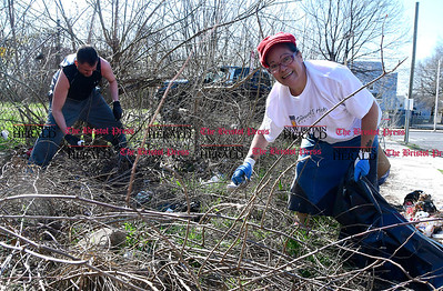 4/15/2017 Mike Orazzi | Staff Edna Colon cleans up on Oak Street during the The North Oak-Neighborhood Revitalization Zone community cleanup Saturday. In the background is Jon Zipadelli.