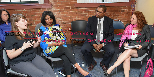 041817  Wesley Bunnell | Staff  Congresswoman Elizabeth Esty D-CT 5th District along with city leaders held a round table discussion on jobs at the New Britain American Job Center on Tuesday afternoon. Stanley Black & Decker recruiter Danielle Johnson, left, disucces Stanley's efforts in the city seated next to Executive Director of A Caring Hand Mary Ann Dunbar, President & CEO of Capital Workforce Partners Alex Johnson and Congresswoman Elizabeth Esty.