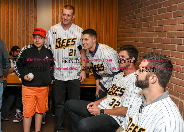 041817 Wesley Bunnell | Staff The New Britain elks Lodge 957 held their 35th Annual Welcome Baseball Dinner featuring The New Britain Bees on Tuesday evening. Matthew Cevallos, age 10, poses for a photo with Mike Hepple (21), Anthony Marzi (12) and Jonathan Pettibone (32).