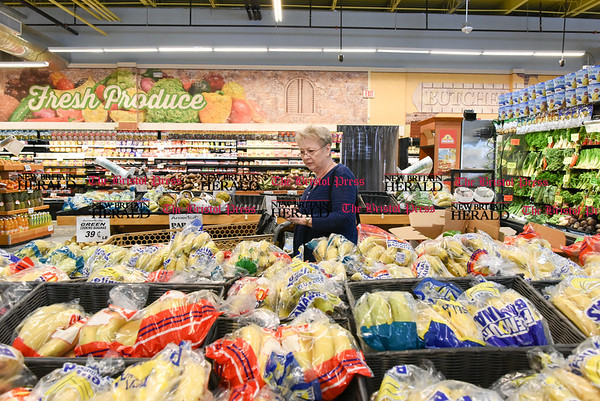 041817 Wesley Bunnell | Staff Beatrice Crumb shops in the produce section of America's Food Basket which recently opened at 250 Allen St in New Britain. A grand opening is planned for later in the month.