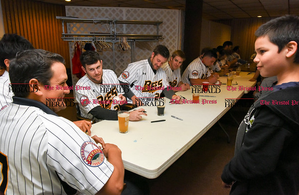 041817 Wesley Bunnell | Staff The New Britain elks Lodge 957 held their 35th Annual Welcome Baseball Dinner featuring The New Britain Bees on Tuesday evening. Catcher Ivan Villaescusa (7) speaks with a young fan.