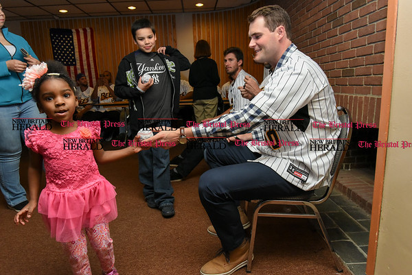 041817 Wesley Bunnell | Staff The New Britain elks Lodge 957 held their 35th Annual Welcome Baseball Dinner featuring The New Britain Bees on Tuesday evening. Nariah Pierre, age 4, receives her autographed baseball from pitcher Brian Dupra (30).