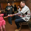 041817  Wesley Bunnell | Staff<br /> <br /> The New Britain elks Lodge 957 held their 35th Annual Welcome Baseball Dinner featuring The New Britain Bees on Tuesday evening. Nariah Pierre, age 4, receives her autographed baseball from  pitcher Brian Dupra (30).
