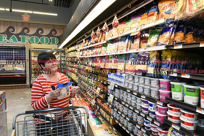 041817  Wesley Bunnell | Staff  Jeanne Fort shops in the dairy section of America's Food Basket which recently opened at 250 Allen St in New Britain. A grand opening is planned for later in the month.