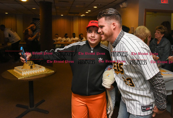 041817 Wesley Bunnell | Staff The New Britain elks Lodge 957 held their 35th Annual Welcome Baseball Dinner featuring The New Britain Bees on Tuesday evening. Matthew Cevallos, age 10, takes a selfie with pitcher Eric Fornataro (23).