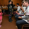 041817  Wesley Bunnell | Staff<br /> <br /> The New Britain elks Lodge 957 held their 35th Annual Welcome Baseball Dinner featuring The New Britain Bees on Tuesday evening. Nariah Pierre, age 4, looks up at pitcher Brian Dupra (30) as he prepares to autograph her baseball.