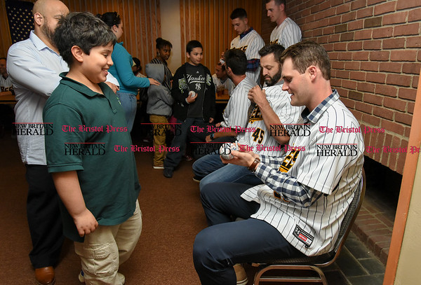 041817 Wesley Bunnell | Staff The New Britain elks Lodge 957 held their 35th Annual Welcome Baseball Dinner featuring The New Britain Bees on Tuesday evening. Xavier Robles, age 9, hands his baseball to pitcher Brian Dupra (30) for an autograph.