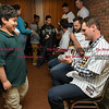 041817  Wesley Bunnell | Staff<br /> <br /> The New Britain elks Lodge 957 held their 35th Annual Welcome Baseball Dinner featuring The New Britain Bees on Tuesday evening. Xavier Robles, age 9, hands his baseball to pitcher Brian Dupra (30) for an autograph.