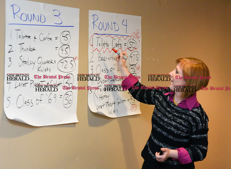 042017  Wesley Bunnell | Staff<br /> <br /> The New Britain Industrial Museum held their first annual trivia night fundraiser at the Elks Club on Thursday night. Kate Hayden circles the nights winner on the final round scoresheet.