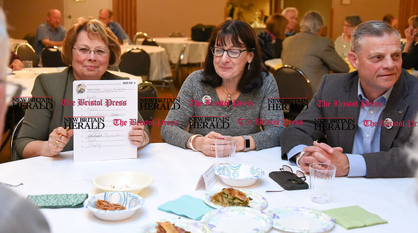 042017  Wesley Bunnell | Staff  The New Britain Industrial Museum held their first annual trivia night fundraiser at the Elks Club on Thursday night. Janice Bradbury holds up the answer sheet for team Dyson Hardware for other teammates to see as she sits next to Julie Dyson and Howard Dyson.