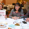 042017  Wesley Bunnell | Staff<br /> <br /> The New Britain Industrial Museum held their first annual trivia night fundraiser at the Elks Club on Thursday night. Janice Bradbury holds up the answer sheet for team Dyson Hardware for other teammates to see as she sits next to Julie Dyson and Howard Dyson.