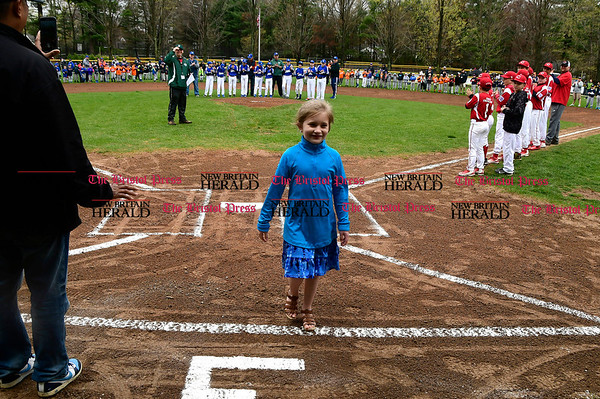 4/22/2017 Mike Orazzi | Staff Haley Powers,7, after singing &quote;The Star-Spangled Banner&quote; on opening day at the Forestville Little in Bristol Saturday.