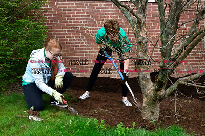 4/22/2017 Mike Orazzi   Staff Sue Brigandi and her daughter Sarah clean up during the 16th annual Comcast Cares Day at the Smith Elementary School in New Britain Saturday.