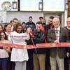 042517  Wesley Bunnell | Staff<br /> <br /> Mayor Erin Stewart along with restaurant owner Vincent Placeres, family and city officials held a ribbon cutting for Mofongo Restaurant which opened recently on West Main St across from city hall.