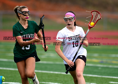 4/26/2017 Mike Orazzi | Staff Bristol lacrosse's Emily Stadnicki (10) and Northwest Catholic's Madison Cote (15) at Bristol Eastern.