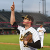 042617  Wesley Bunnell | Staff<br /> <br /> New Britain Bees vs Lancaster Barnstormers on Wednesday evening. Jon Griffin (33) tosses a ball to a fan as he runs off the field.