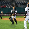 042617  Wesley Bunnell | Staff<br /> <br /> New Britain Bees vs Lancaster Barnstormers on Wednesday evening. James Skelton (3) watches as Jon Griffin (33) calls him off on a pop up near the Bees bench.