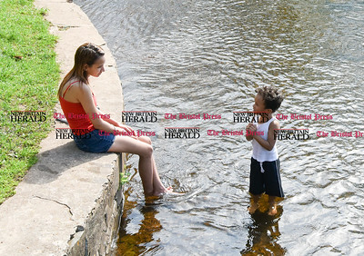 042817  Wesley Bunnell | Staff  Justin Serrano, age 4, stands in a stream at A.W. Stanley Park as he talks with his mother Zuleika Casino on a warm Friday afternoon.