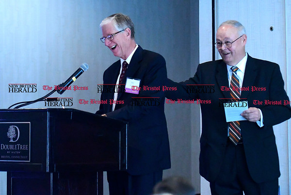 4/28/2017 Mike Orazzi | Staff Incoming Chairman of the Board Doug Devnew while Outgoing Chairman of the Board of Bristol Hospital John Leone Jr. during the Annual Corporators Meeting at the DoubleTree by Hilton Thursday morning.