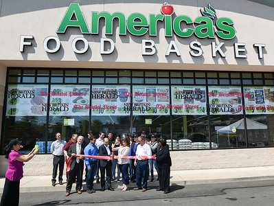 042817  Wesley Bunnell | Staff  America's Food Basket held a ribbon cutting at their new store located at 250 Allen St. Front row is Economic Development Director Bill Carroll, Andy Ferreira, owner Andres Ferreira, Mayor Erin Stewart, President of the New Britain Chamber of Commerce Tim Stewart & Alderwoman Shirley Black.