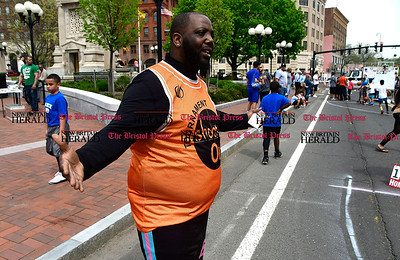 4/29/2017 Mike Orazzi   Staff Mario Davis while coaching his children in downtown New Britain during the Hoops for Homeless event Saturday.