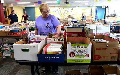 4/29/2017 Mike Orazzi | Staff Stella Heyl while sorting Polish books at the New Britain Public Library Saturday.