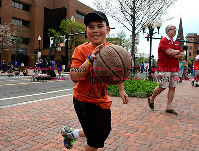 4/29/2017 Mike Orazzi | Staff Jelian Lisboa,8, in downtown New Britain during the Hoops for Homeless event Saturday.