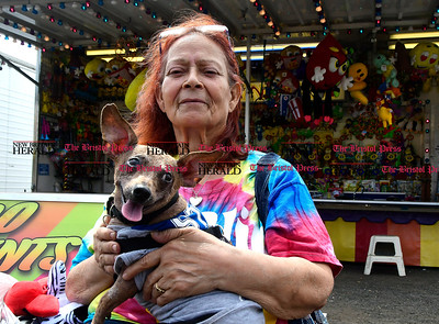 4/29/2017 Mike Orazzi | Staff Hilda Rosario and her dog Mickey Mouse during the United Way carnival in downtown Bristol Saturday.