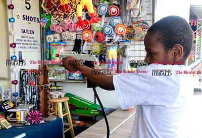 4/29/2017 Mike Orazzi | Staff A.J. Garner plays a shooting game during the United Way carnival in downtown Bristol Saturday.