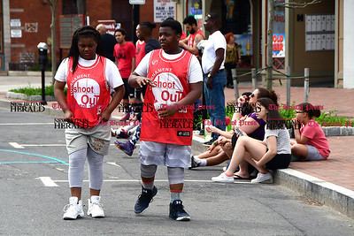 4/29/2017 Mike Orazzi | Staff Siblings Kiarra and Khalil Davis in downtown New Britain during the Hoops for Homeless event Saturday.