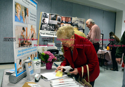 3/26/2016 Mike Orazzi | Staff Lois Taft fills out a raffle card during the second annual Connecticut Prime Time Senior Fair held at Bristol Eastern High School Saturday.