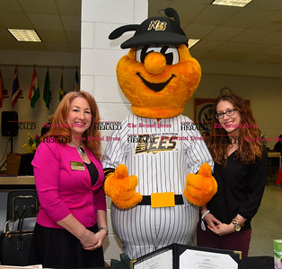 3/26/2016 Mike Orazzi | Staff The New Britain Bees mascott with Landing of Farmington's Hollis Hartman and Samantha Christensen during the second annual Connecticut Prime Time Senior Fair held at Bristol Eastern High School Saturday.