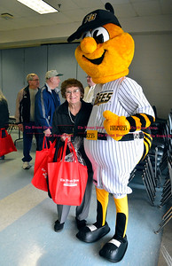 3/26/2016 Mike Orazzi | Staff The New Britain Bees mascot with Jean Myska during the second annual Connecticut Prime Time Senior Fair held at Bristol Eastern High School Saturday.