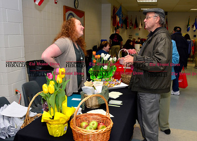 3/26/2016 Mike Orazzi | Staff Sheriden Woods Health Care Center's Tina Sears talks with Bob Mathis during the second annual Connecticut Prime Time Senior Fair held at Bristol Eastern High School Saturday.