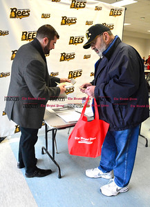 3/26/2016 Mike Orazzi | Staff The New Britain Bees' Jerry Maust talks with Robert Badal during the second annual Connecticut Prime Time Senior Fair held at Bristol Eastern High School Saturday.