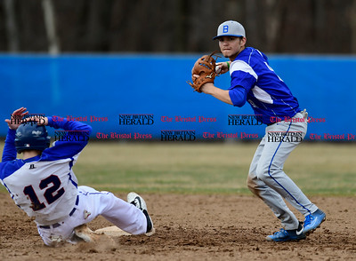 4/5/2017 Mike Orazzi | Staff Bristol Eastern's Cory Fradette (8) gets a force out on Plainville's Tyler St. Onge (12).
